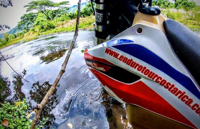 Crossing river enduro tour costa rica